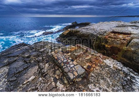 Rocks of Ionian Sea seen from Ortygia isle Syracuse city Sicily Island in Italy