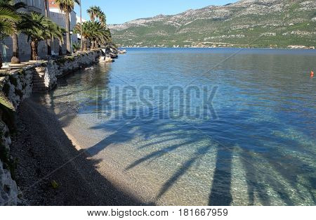 KORCULA, CROATIA - NOVEMBER 09: Clear water at the waterfront of Korcula town, Croatia on November 09, 2016.