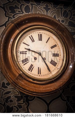Ancient vintage wall clock of the early twentieth century, verical image