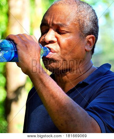African american male dealing with a hot summer day weather in the south.