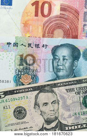 Euro, China Yuan And Us Dollar Banknotes