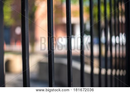 behind bars outside trapped on one side