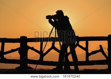 Man Photographer is Taking Pictures Silhouette Concept.