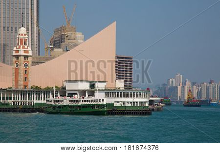 HONG KONG - APRIL 2: Ferry docked on Kowloon pier on April 2, 2017 in Hong Kong, China. Hong Kong ferry is in operation for more than 120 years and is one of main attractions of the city.