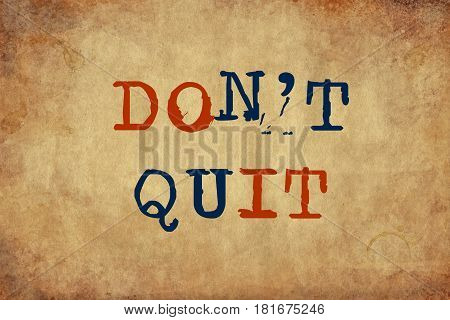 Inspiring motivation quote with typewriter text Don't Quit. Distressed Old Paper with Typing image.