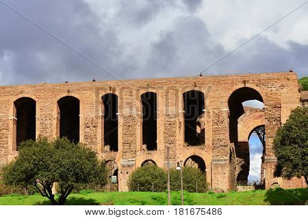 ROME, ITALY - MARCH 5: Tourists visit Palatine Hill Imperial Palace monumental arcade in Rome during a cloudy day MARCH 5, 2017 in Rome, Italy