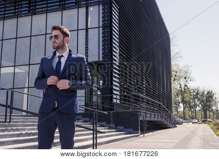 One Young Man, Buttoning Shirt, Street Modern Building