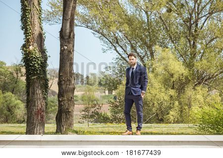 One Young Man, Formal Clothes Suit Shoes, Standing On Wall, Nature Outdoors