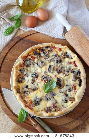 Mushrooms and bacon french quiche. Top view