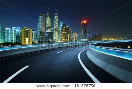 Highway overpass modern city skyline background .Night scene .