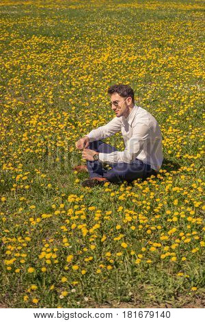 One Young Man, Sitting Flower Field, Outodoors, Sunny Day