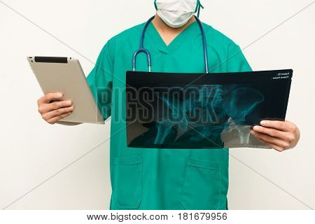 Asian Male Medical Doctor Using Tablet On White Background