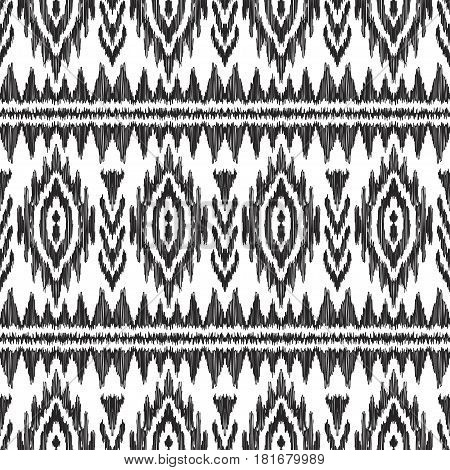 Vector illustration of black and white colored Ikat seamless pattern. Navajo, aztec ornament. American ethnic backdrop.