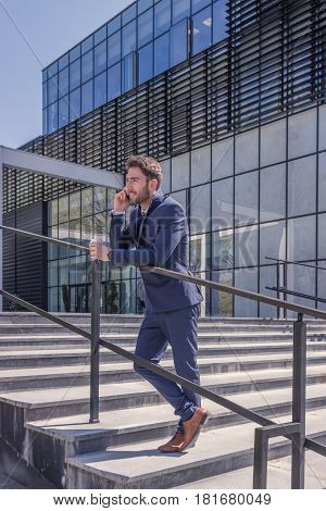 One Young Man, Suit Tie, Talking Over Phone, Outdoors Day, Modern Building