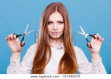 Professional Hairdresser Dual Wielding Scissors.