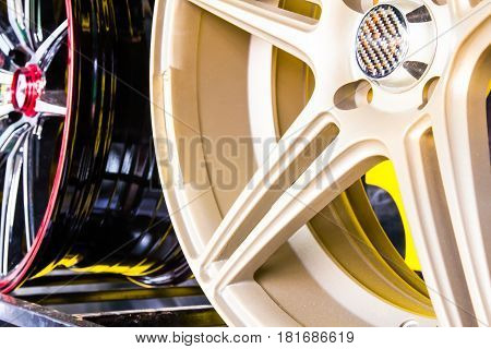 Close up various alloy wheels in store