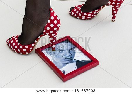 picture frames and heeled shoe