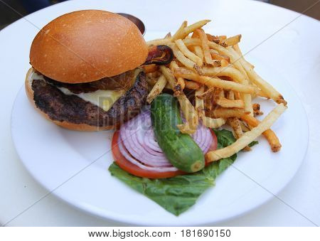 Cheeseburger  with French Fries served in restaurant