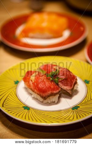 Rare Japanese Gyuuniku Beef Tataki Nigiri Sushi Close Up