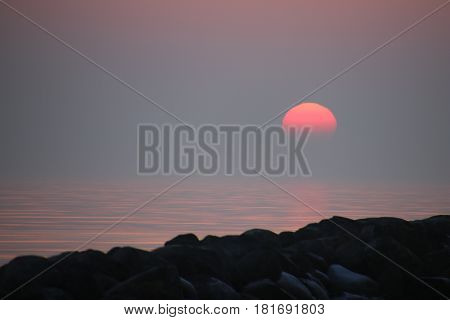The sun disappears into the sea in February
