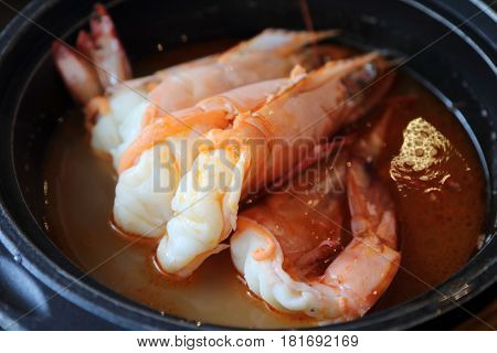 Big prawn soup that is part of a unique Singapore and Malaysia dish of big prawn noodle