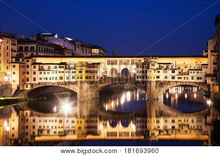 amazing Florence - travel in Italy series - Ponte Vecchio after sunset with reflections on Arno river