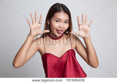 Young Asian Woman Sticking Her  Tongue Out.
