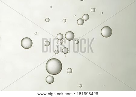 A group of beautiful air bubbles soars over a gradient background