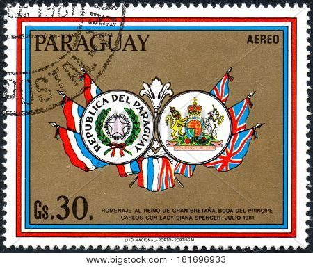 UKRAINE - CIRCA 2017: A postage stamp printed in Paraguai shows Coat of Arms of Paraguay and Great Britain from the series Wedding of Prince Charles and Lady Diana circa 1981