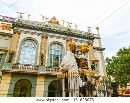 Figueres, Spain - September 15, 2015: The Monument to the Catalan philosopher Francesc Puzholsu in front of the theater and the museum of Salvador Dali in Figueres, Spain on September 15, 2015