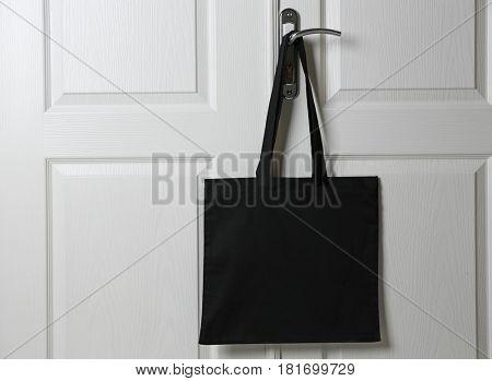 Textile bag hanging on door handle