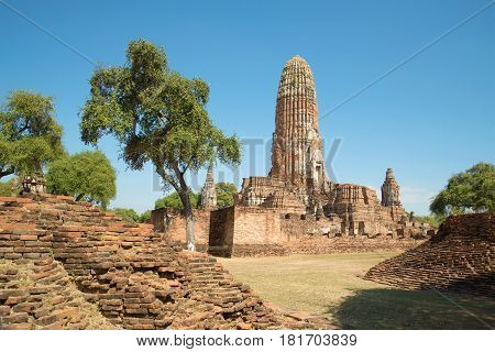 Ruins of the ancient Buddhist temple of Wat Phra Ram in the sunshine. View of the main Prang. Ayutthaya, Thailand