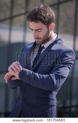One Young Man, Suit Tie, Looking At Watch