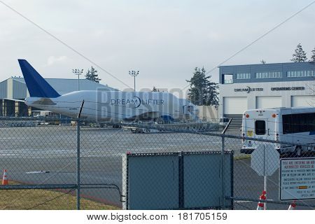 EVERETT, WASHINGTON, USA - JAN 26th, 2017: Boeing 747 Dreamlifter parking at Snohomish County Airport or Paine Field. The Dreamlifter is used exclusively to transport 787 Dreamliner parts to the Boeing factory.