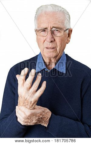 Portrait Of Senior Man Suffering With Arthritis