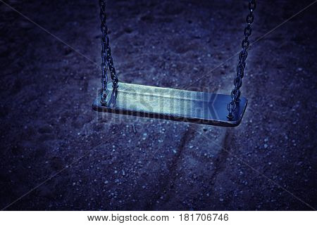 Photography of a empty chain swing in playground