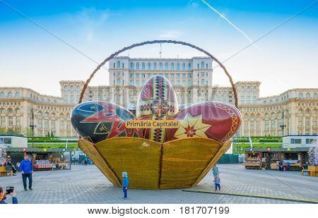 Bucharest Romania - 16 April 2017: Big traditional eggs in front of the famous Parliament building in Easter where was organized a traditional religious market Christian celebration holiday