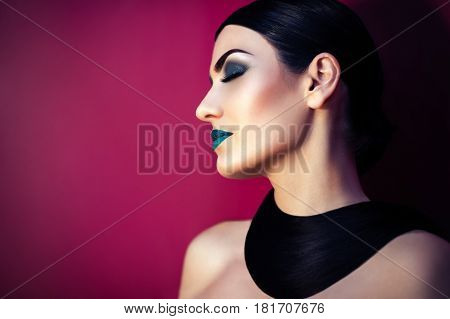 beautiful woman with turquoise make-up and fashionable hairstyle