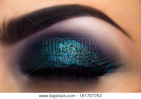 beautiful bright makeup eyes macro in studio