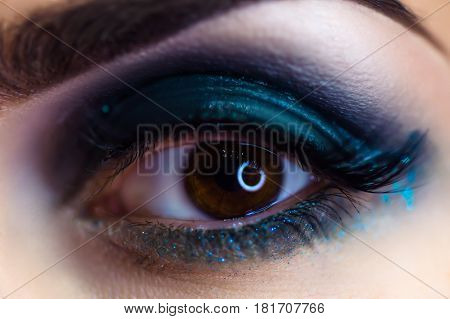 beautiful woman makeup eye macro in studio