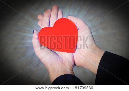 Energy heart in the beuatiful girl hands