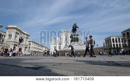 MILAN ITALY - APRIL 4 2017: Duomo square crowded with people on a sunny afternoon