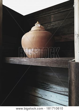 The traditional clay pot making in Thailand by the professional clay,Pottery Clay handmade Craft product on wooden shelf,