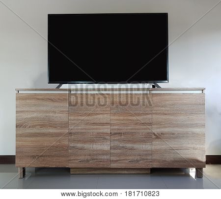 Living room led TV on wooden table media furniture,Empty living room led TV on wooden table old wood floor interior.