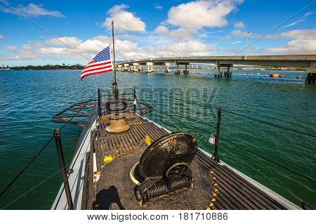 HONOLULU, OAHU, HAWAII, USA - AUGUST 21, 2016: American Flag in prow of the USS Bowfin Submarine SS-287. Pearl Harbor historic landmark, patriotic symbol and memorial of the Japanese attack in WW II.