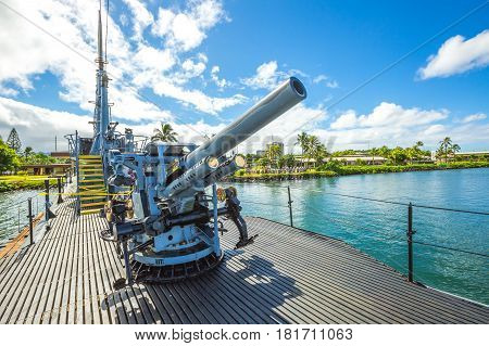 HONOLULU, OAHU, HAWAII, UNITED STATES - AUGUST 21, 2016: Submarine machine gun of the USS Bowfin SS-287 at Pearl Harbor memorial site. National historic and patriotic landmark.