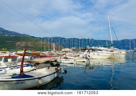BUDVA MONTENEGRO - SEPTEMBER 15 2015: Pleasure boats and yachts at pier on waterfront of resort of Budva Montenegro