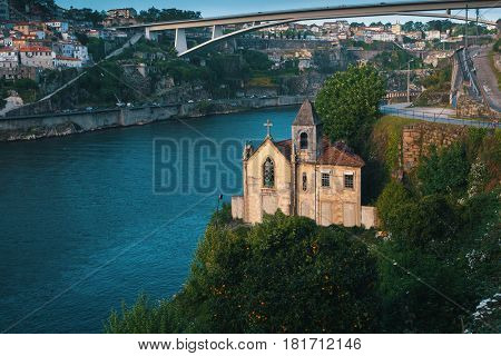 Abandoned Church on the banks at Douro river, Porto, Portugal.
