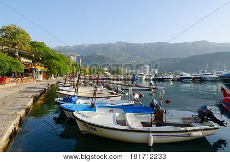 BUDVA MONTENEGRO - SEPTEMBER 18 2015: Pleasure boats and yachts at pier on waterfront of resort of Budva Montenegro