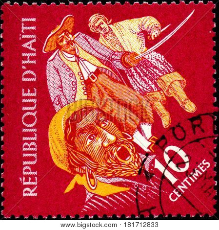UKRAINE - CIRCA 2017: A postage stamp printed in Haiti shows three Pirates from the series Tourism. History of Tortuga Island circa 1961